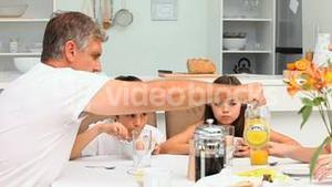 Family breakfast with orange juice and cereal