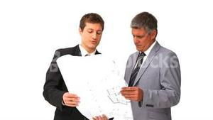Architects holding a building plan