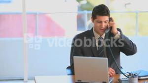 Handsome businessman talking on the phone