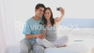 Lovely couple taking a photo of themself