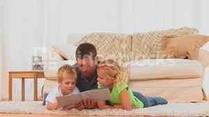 A father reading a book with his children