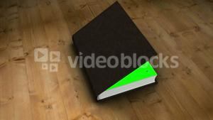Book opening to green screen