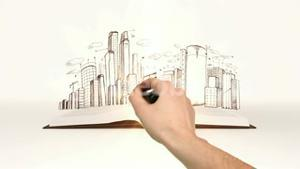 Book opening to cityscape sketch