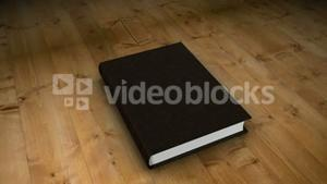 Book opening on wooden table