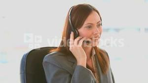 Smiling businesswoman speaking on the phone