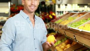 Man picking out fruit in supermarket
