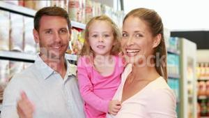 Happy family in the supermarket