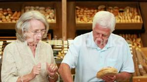 Senior couple shopping in grocery store