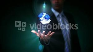 Businessman presenting holographic cubes
