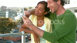 Happy business couple looking at a smartphone