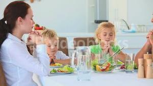Family praying at the table