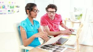 Casual designers working on a photo catalog