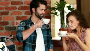 Happy hipster friends drinking coffee