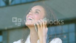 Happy hipster girl talking on the phone