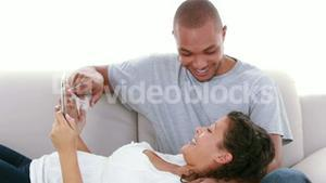 Cute couple looking at ultrasound scan of baby