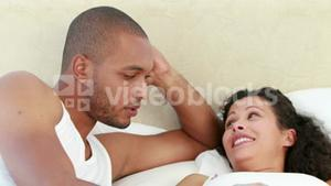 Young couple discussing together on the bed