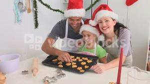 Family cooking some cakes