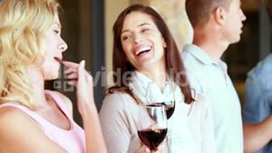 Smiling group discussing and holding their wineglasses