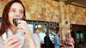 Smiling woman drinking a red wine glass