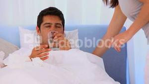 Woman taking care of her sick husband