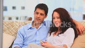 Couple watching tv on the sofa