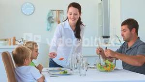 Parents serving food to their children