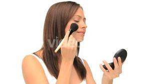 Coquette woman putting on makeup