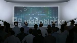 Business people watching data interface on screen