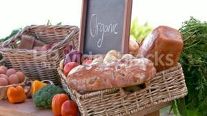 Overview of organic vegetables on stall in slow motion