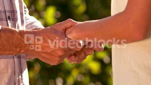 Couple holding hands in slow motion
