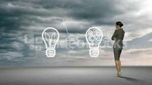Businesswoman watching idea concept in the sky