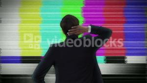 Businessman looking at static tv