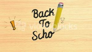 Back to school writing on wooden desk