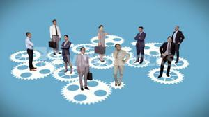 Business people standing on moving cogs and wheels