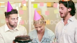 Smiling casual business team celebrating birthday
