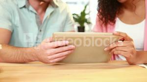 Graphic designers working with tablet computer