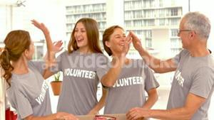 Group of Volunteers doing high fives
