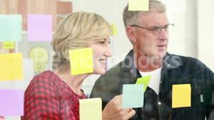 Creative businessman looking at post-it