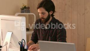 Casual hipster designer working on a computer
