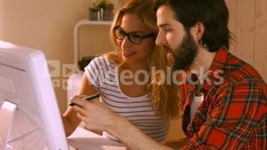 Casual designers working together on a computer