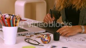 Graphic designer using digitizer at her desk
