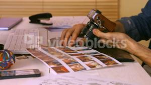 Photo editor working at his desk