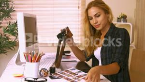 Pretty photo editor working at her desk