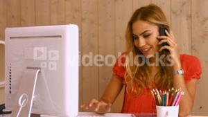 Pretty worker phoning at desk