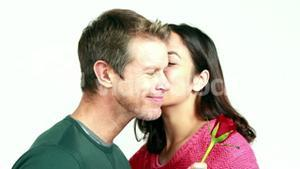 Smiling couple bing romantic together