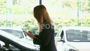 Businesswoman checking out a car