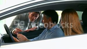 Customers taking a look at a car