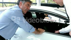 Businessman explaining the car details