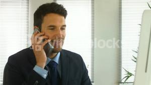 Businessman finishing a phone call