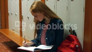 Student writing into her school journal